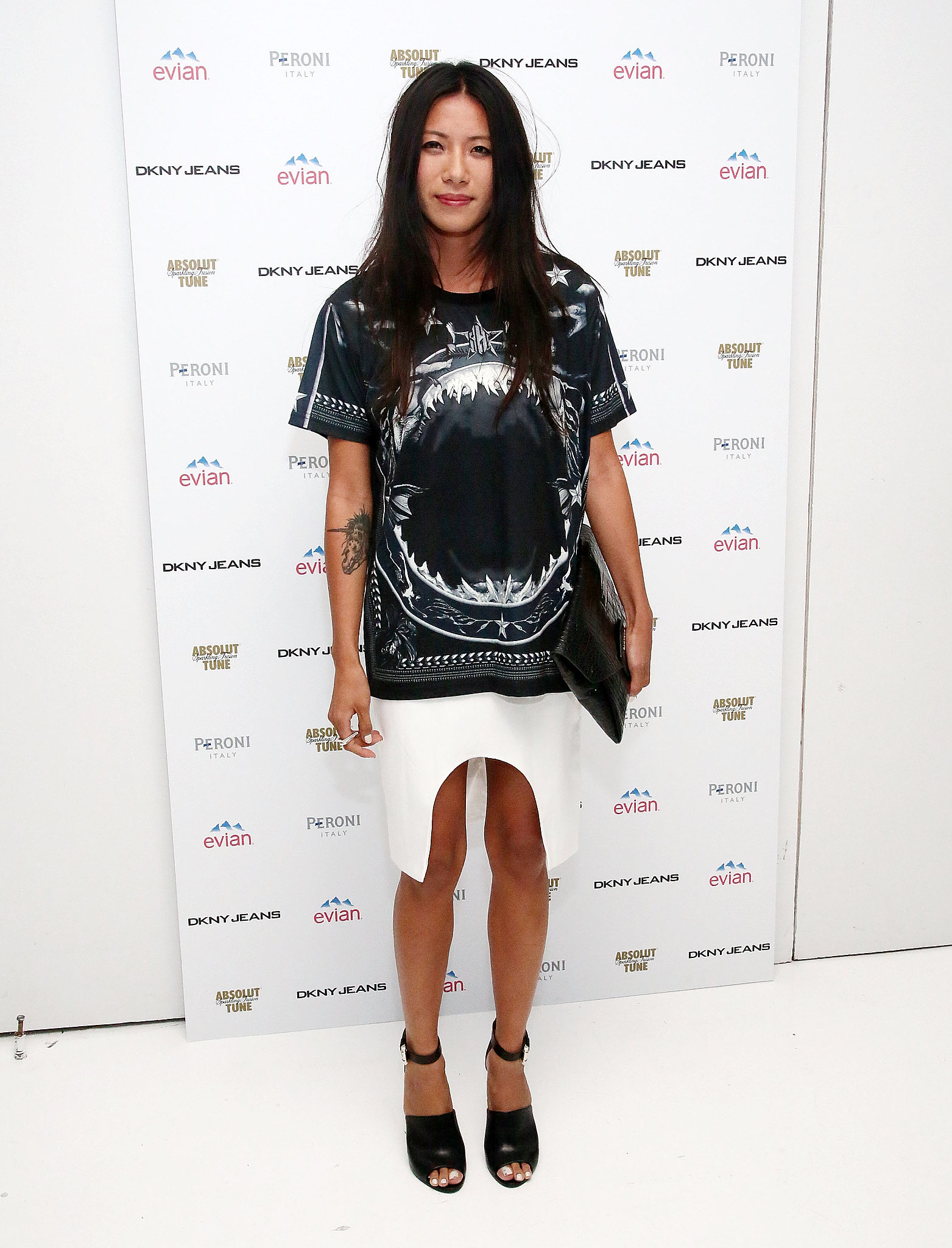 At DKNY's birthday bash for Chelsea Leyland, May Kwok helped get the party going in black and white.
