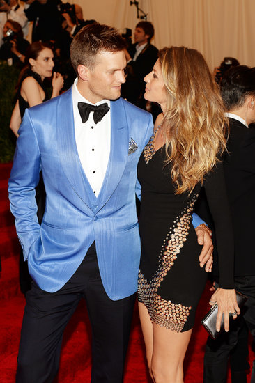 Tom Brady held his wife, Gisele Bündchen, close on the red carpet at NYC's Met Gala in May 2013.