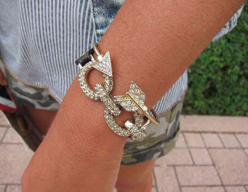 A little Lollapalooza bling never hurt anybody. We're partial to this rhinestone-encrusted arrow cuff.