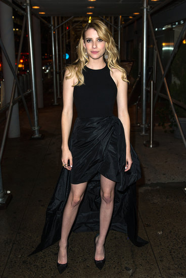 Emma Roberts made her way out of the We're the Millers premiere in her asymmetric black Michael Kors dress and Casadei heels.
