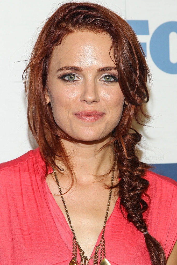 Dexter star Katia Winter wore her tousled red hair in a piecey fishtail braid.