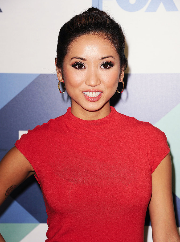 Brenda Song wore her hair in a polished bun with a sexy smoky eye at the Fox party.
