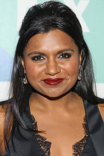 Also at the Fox event, Mindy Kaling stepped out in a formfitting LBD. She went for a half-updo with plenty of volume at the crown. She finished off the classic look with a swipe of brick-red lipstick.