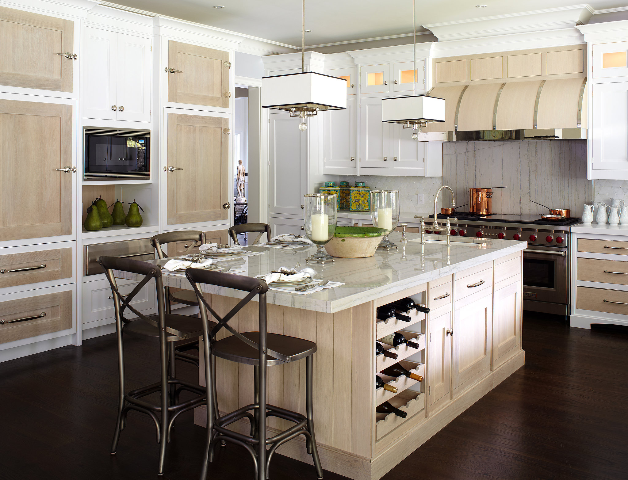 Pale wood cabinetry white paint lend eternal summer vibe