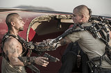 Jose Pablo Cantillo and Matt Damon in Elysium.