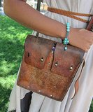 This structured vintage leather purse proved durable during a raucous festival.