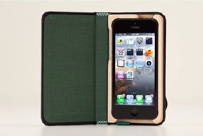 The Little Black Book iPhone 5 case ($40) disguises your iPhone as a little black book, secured by a hand-carved wooden frame and wraparound strap. The inside of the case is lined, making it look even more like an adorable, pocket-sized notebook.