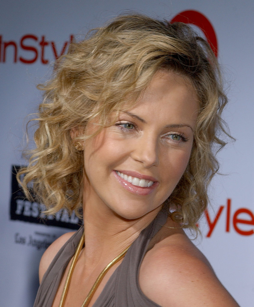 Charlize was honored with the Spirit of Independence Award in 2006, opting for a youthful and spunky style for the ceremony. She stuck to a girl-next-door look, with her signature kinky curls and neutral makeup palette.