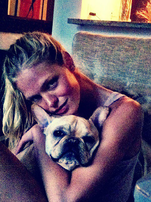 Victoria's Secret Angel Erin Heatherton spends lots of time cuddling with her French bulldog, Eddie. Source: Twitter user ErinHeatherton