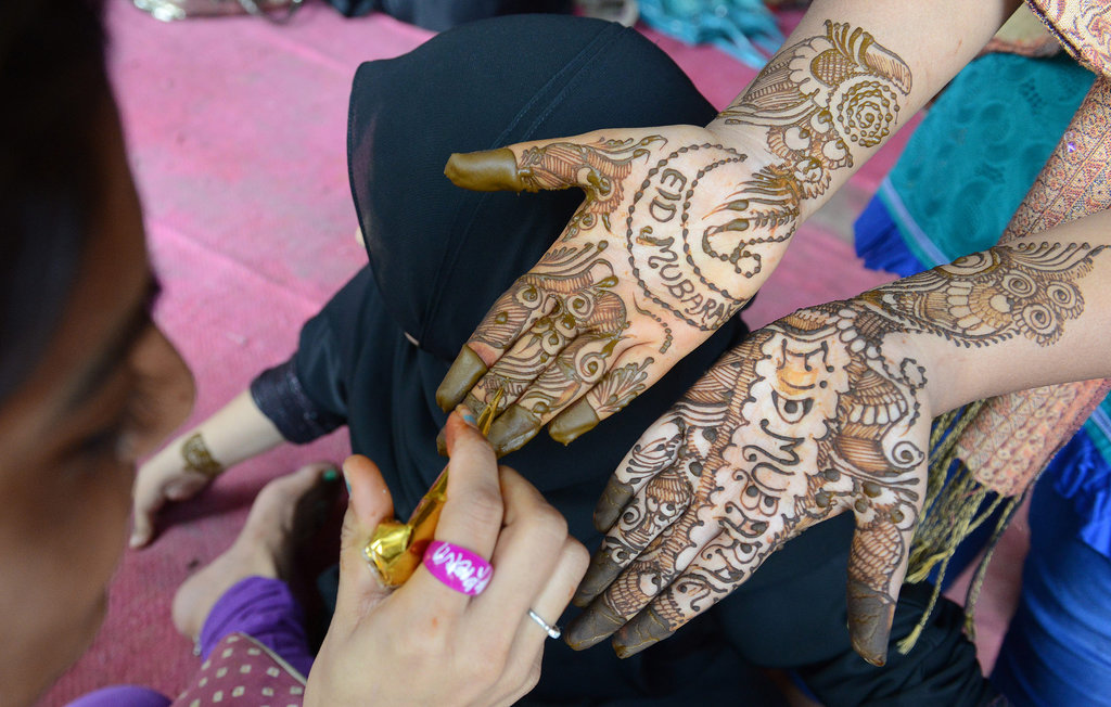 A woman in Hyderabad, India, had her hands painted with a henna design.
