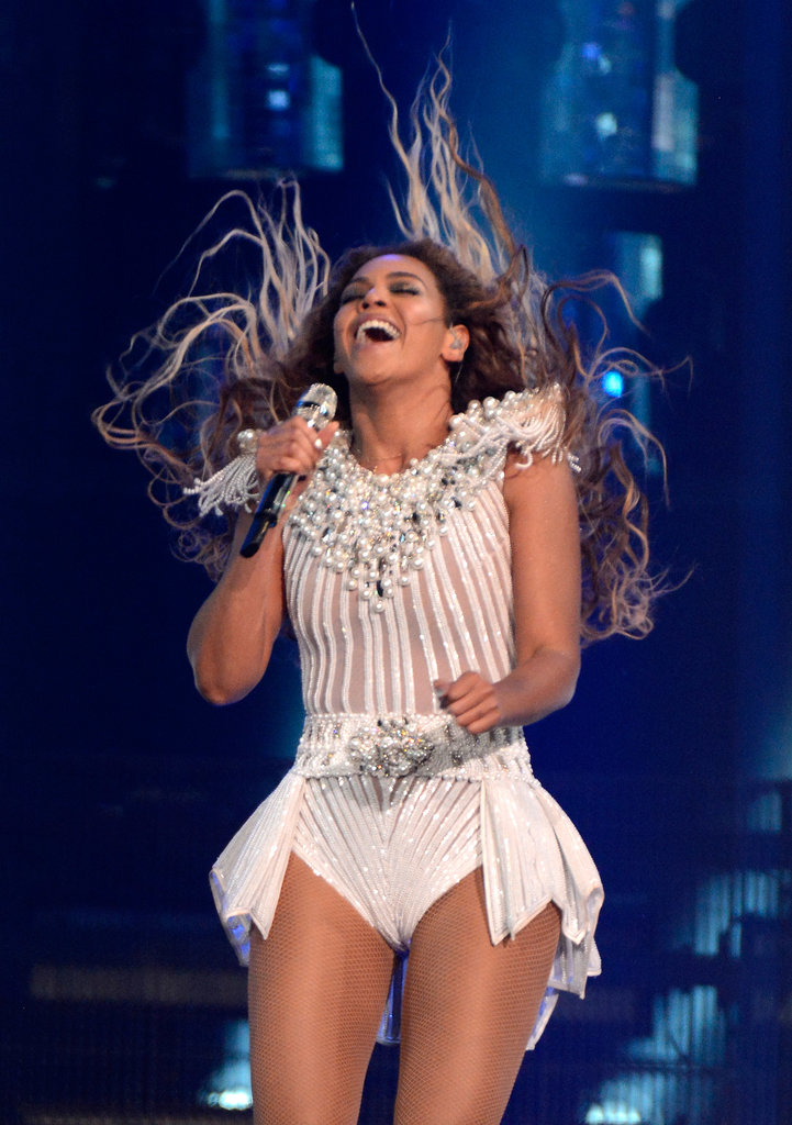 On the opening night of the Mrs. Carter World Tour in Los Angeles, Beyoncé's extralong locks reached almost to her waist in this hair flip.