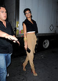 Rihanna exuded preppy polish, with her signature rock-chic twist, in a navy cropped vest, camel high-waisted trousers, and leopard pumps during a 2009 NYC trip.