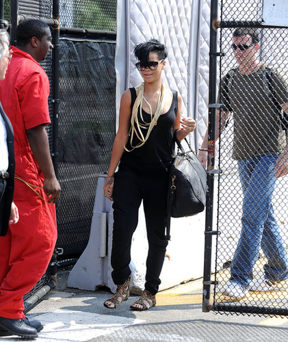 Nothing pairs better with a trendy black jumpsuit than leopard sandals and layers of gold necklaces.