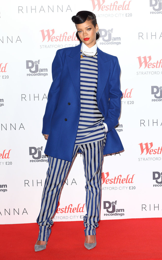 The singer took borrowed-from-the-boys to heart in a blue and gray striped top and matching trousers, both from Acne's men's Spring 2013 collection, and a statement cobalt men's coat from Raf Simons while lighting the Westfield Stratford City Christmas lights in London.