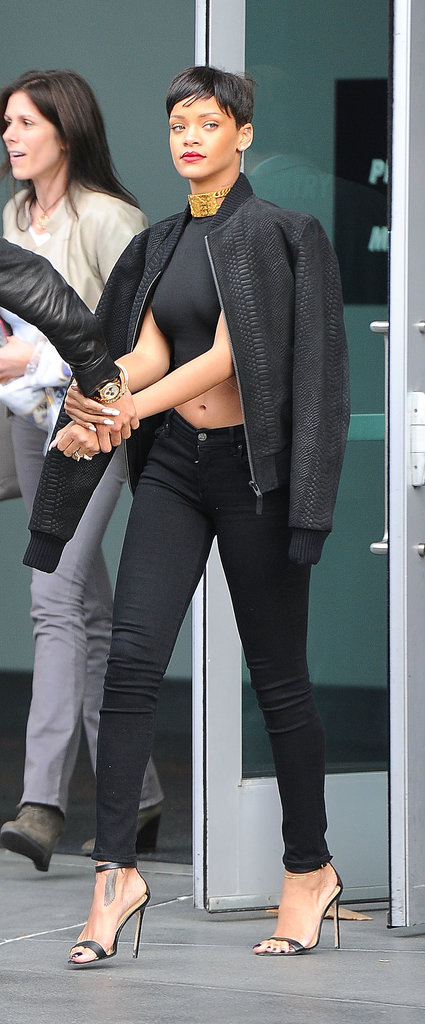 In 2012, Rihanna caught the Lakers' Christmas Day game in LA donning a cropped top with Citizens of Humanity skinny jeans, ankle-strap Manolo Blahnik sandals, and a textured varsity jacket. She accessorized her monochromatic ensemble with a wide gold choker, futuristic shades, and her favorite Jacquie Aiche body chain.