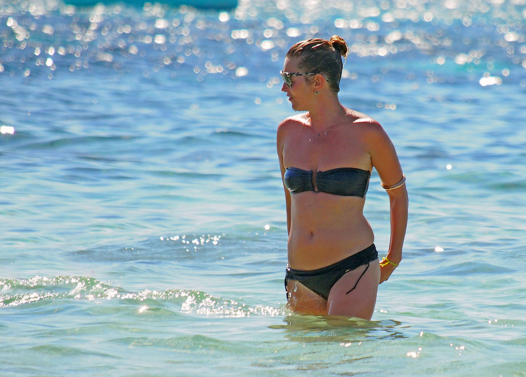 In August, Kate Moss wore a black bikini to take a dip in the water in Spain.