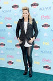 Demi Lovato rocked some serious leather leggings on the Teen Choice carpet.