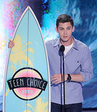 Logan Lerman accepted an award at the Teen Choice Awards.