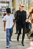 Angelina Jolie wore a black blouse and skinny jeans.