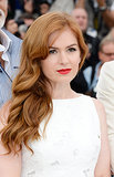 Someone once said that redheads should steer clear of red lipstick, but Isla Fisher proves that scarlet strands and ruby lipstick make a fine pair.