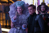 Elizabeth Banks as Effie and Josh Hutcherson as Peeta in Catching Fire.