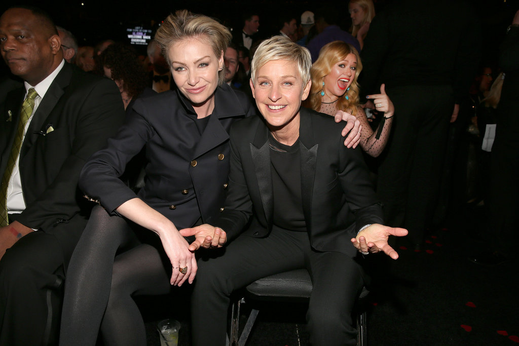 Ellen DeGeneres and Portia de Rossi cuddled (and got photobombed by Kelly Clarkson) at the 2013 Grammy Awards in February 2013.