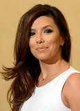 Eva Longoria stuck to her signature look: gold eye makeup, extralong lashes, sideswept waves, and a nude lip gloss.