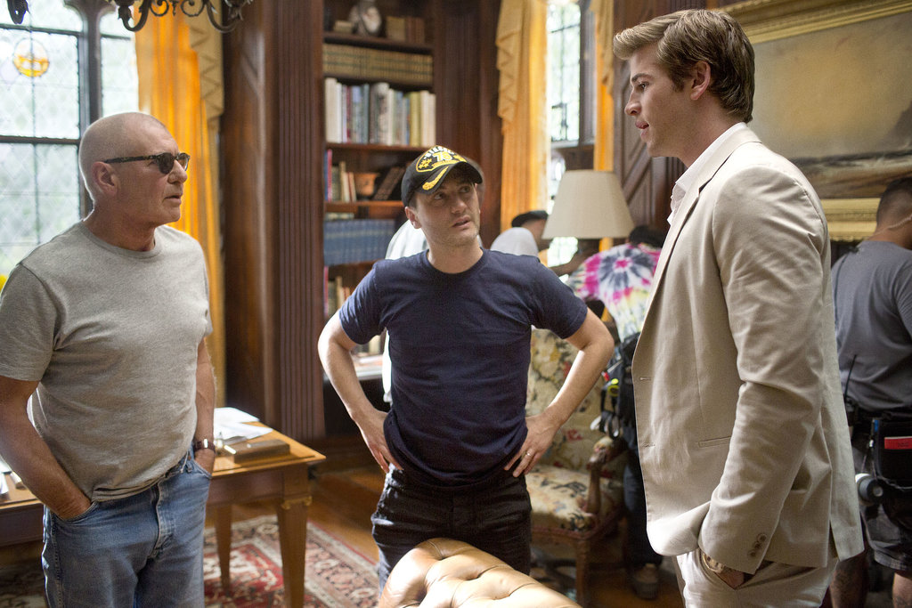 Harrison Ford and Liam Hemsworth on the set with director Robert Luketic.