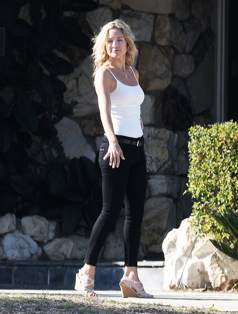 Kate Hudson showed off her body in tight black pants and a white tank top on set in LA.