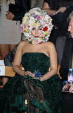 Lady Gaga not only wore a floral headpiece by Philip Treacy while sitting front row at his Spring 2013 runway, but also opened the show.