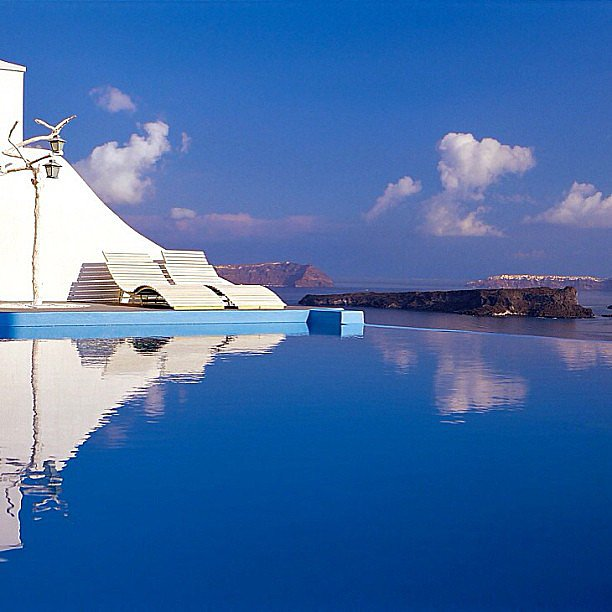 This serene pool is part of Astarte Suites Hotel in Santorini, Greece. Could you imagine?  Source: Instagram user santorini_greece