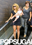 Shakira carried her son, Milan, through LAX before hopping on a flight on Thursday.