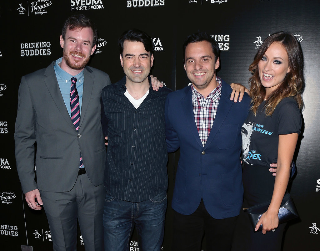 Olivia Wilde was all smiles while posing with her Drinking Buddies costars Ron Livingston and Jake Johnson.