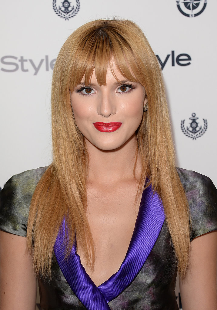 Bella Thorne chose a more mature look, pairing her blunt bangs and sleek, straight hair with a pop of red on her lips.