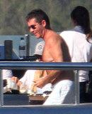 Simon Cowell went shirtless on a yacht in Sardinia, Italy.