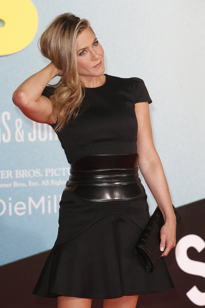 Jen completed the simple black dress with a wide, waist-defining belt.