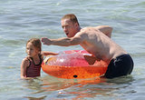 Damian Lewis played with his daughter in the water.