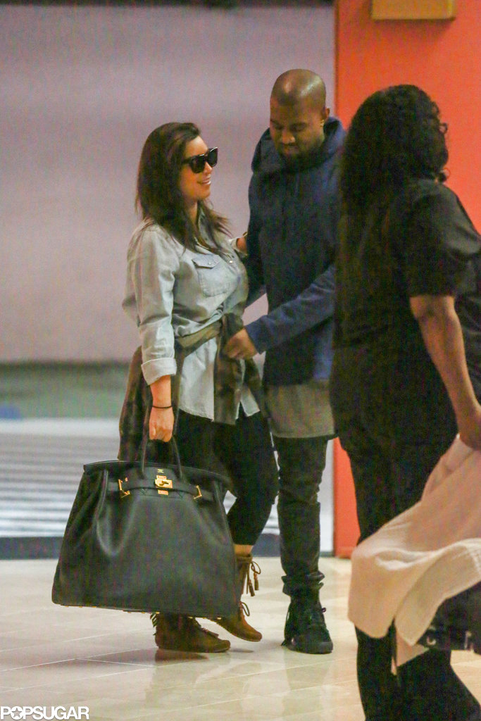Kim Kardashian and Kanye West smiled and laughed.