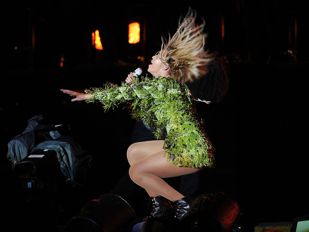 Beyoncé Knowles flipped her hair while performing on stage in the UK.