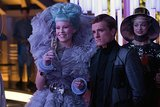 Effie and Peeta share a moment.