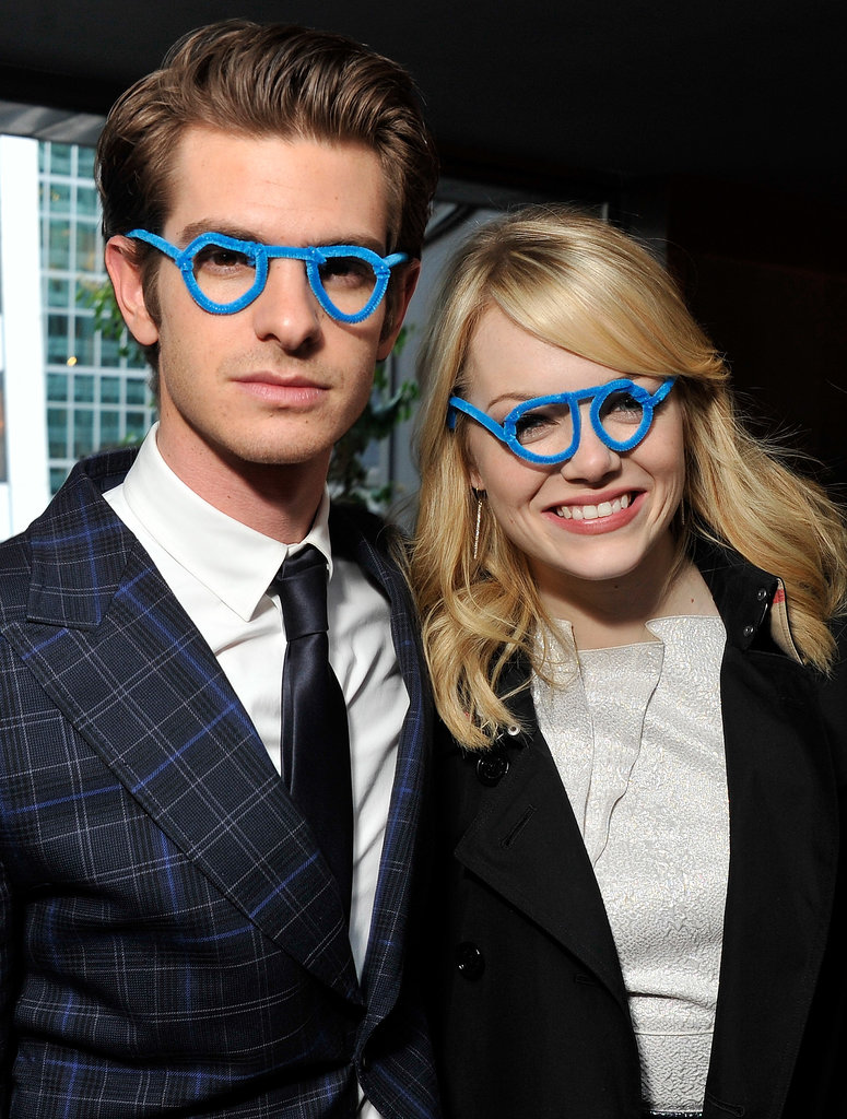 Andrew Garfield and Emma Stone weren't afraid to laugh at themselves donning matching blue glasses at a charity event in NYC in June 2012.