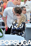 Andrew gave Emma a sweet kiss at a breast cancer benefit honoring her mom in New Jersey in May 2013.