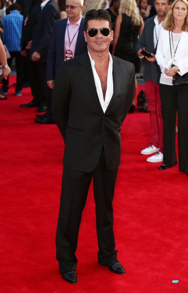 Simon Cowell showed off his chest on the red carpet.