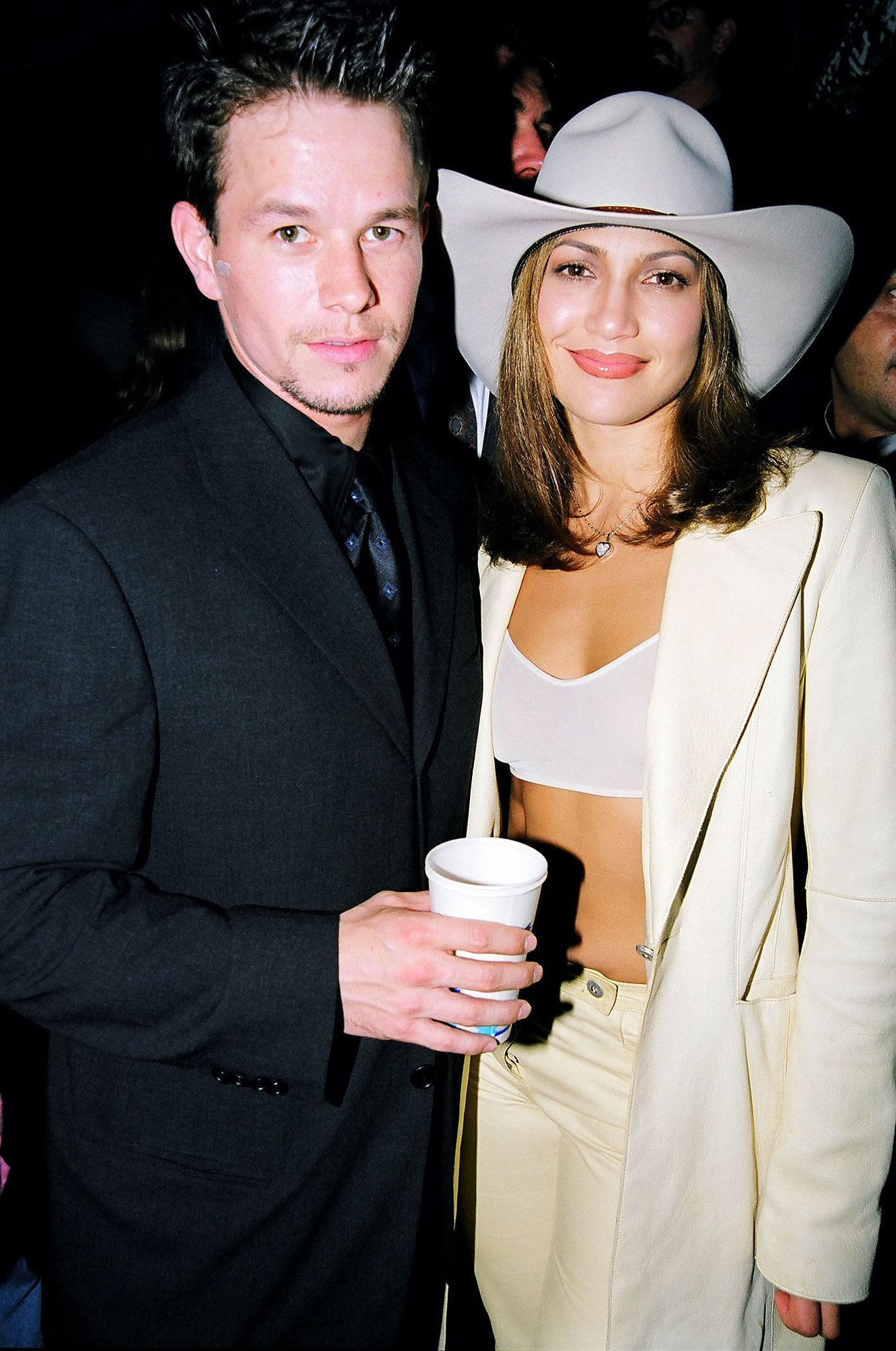 Jennifer Lopez showed off her abs under a blazer while posing with Mark Wahlberg at the 1998 awards.