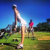 Behati Prinsloo got a little naughty while hitting the links. Source: Instagram user behatiiprinsloo