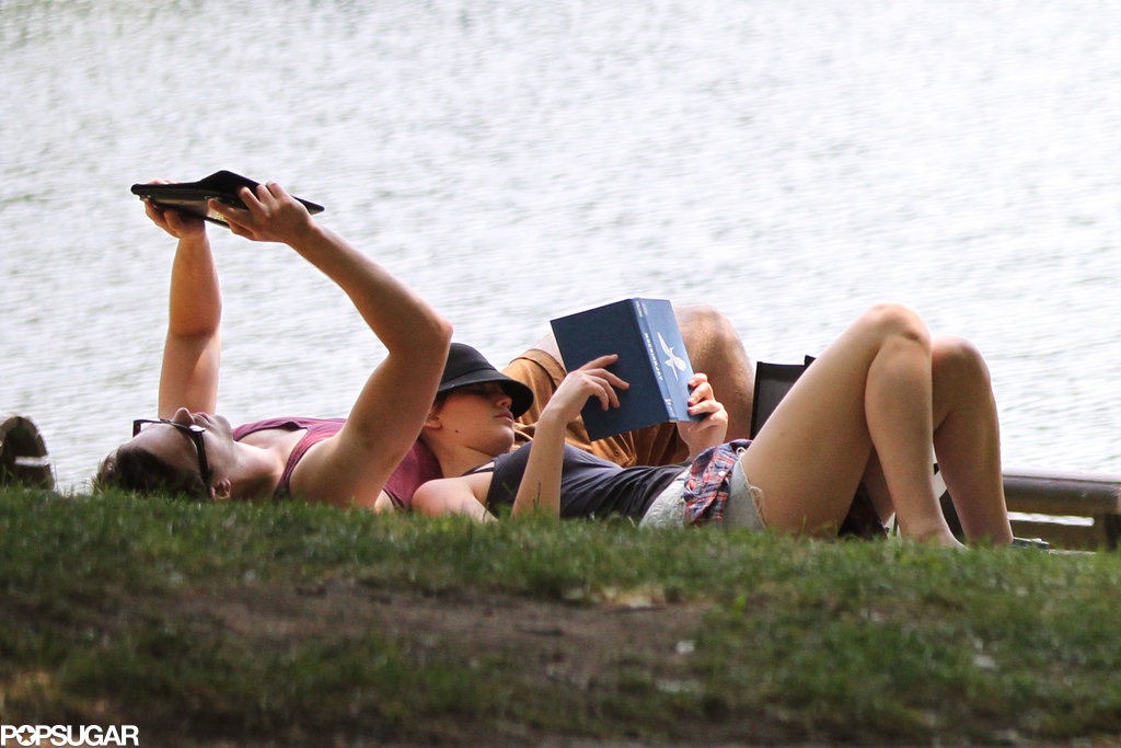 Jennifer Lawrence and Nicholas Hoult spent time reading together on the grass.