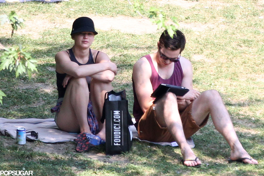 Jennifer Lawrence relaxed in the shade while Nicholas Hoult read.