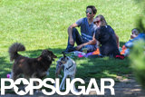 Amanda Seyfried and Justin Long sat on a blanket at the park.