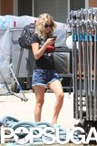 Kate Hudson showed off her legs in short denim shorts on her LA set.