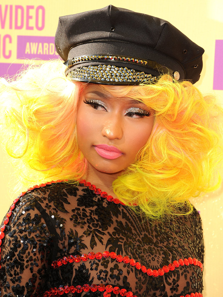 Nicki Minaj never disappoints with extreme red carpet looks, and at the 2012 VMAs she wore a sunshine yellow hairpiece and her signature bubblegum lipstick.